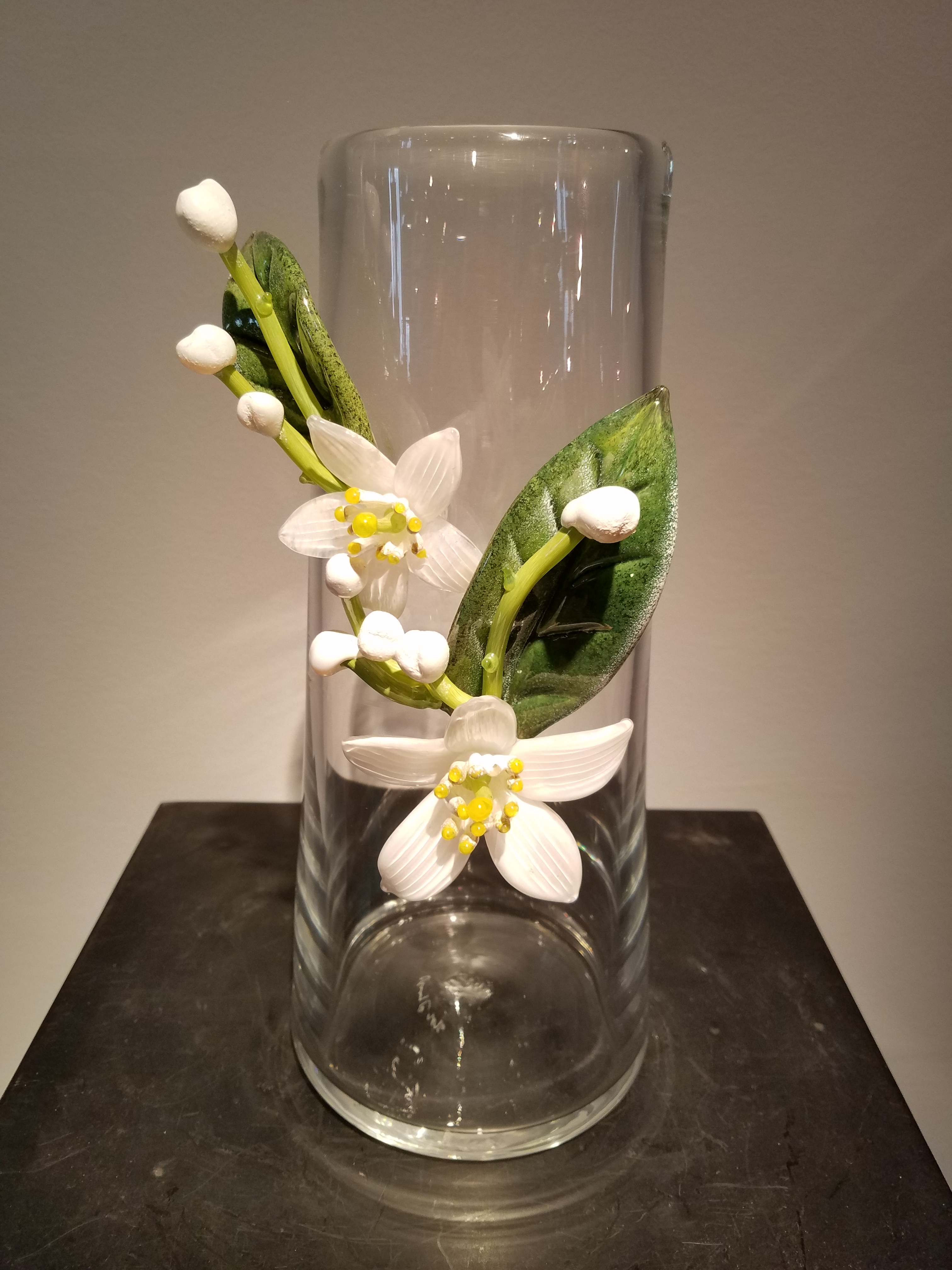 Blown glass vase with hot-sculpted flower