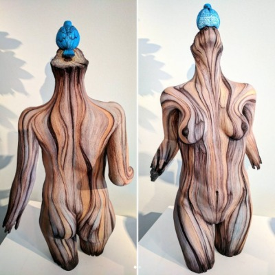 Female Figure in ceramic to look like carved wood