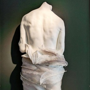 Figurative cast glass wall figure by Mary Van Cline