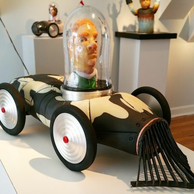 Sculpted glass car with person by Danny White