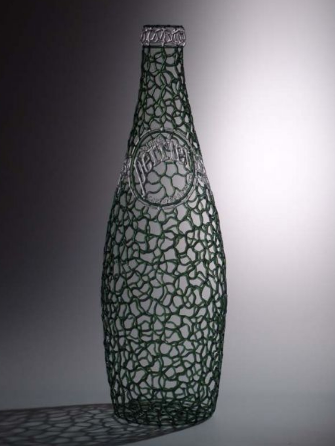 Flameworked glass Perrier bottle by Robert Mickelsen