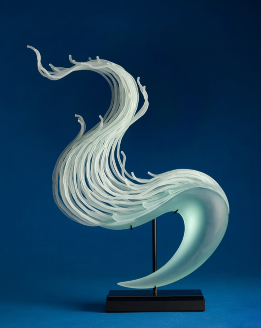 Carved and laminated glass sculpture by William LeQuier
