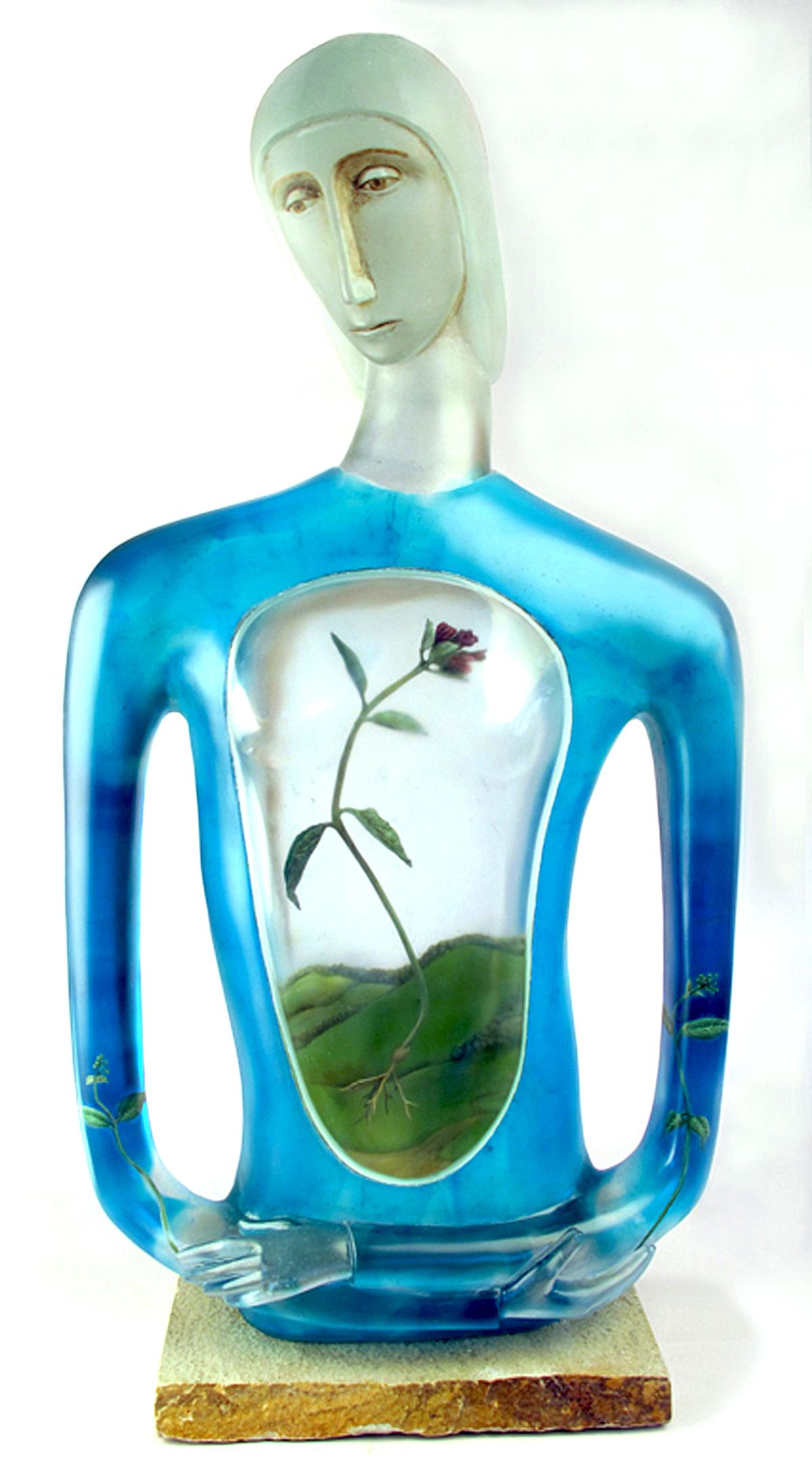 Cast glass figure by Robin Grebe