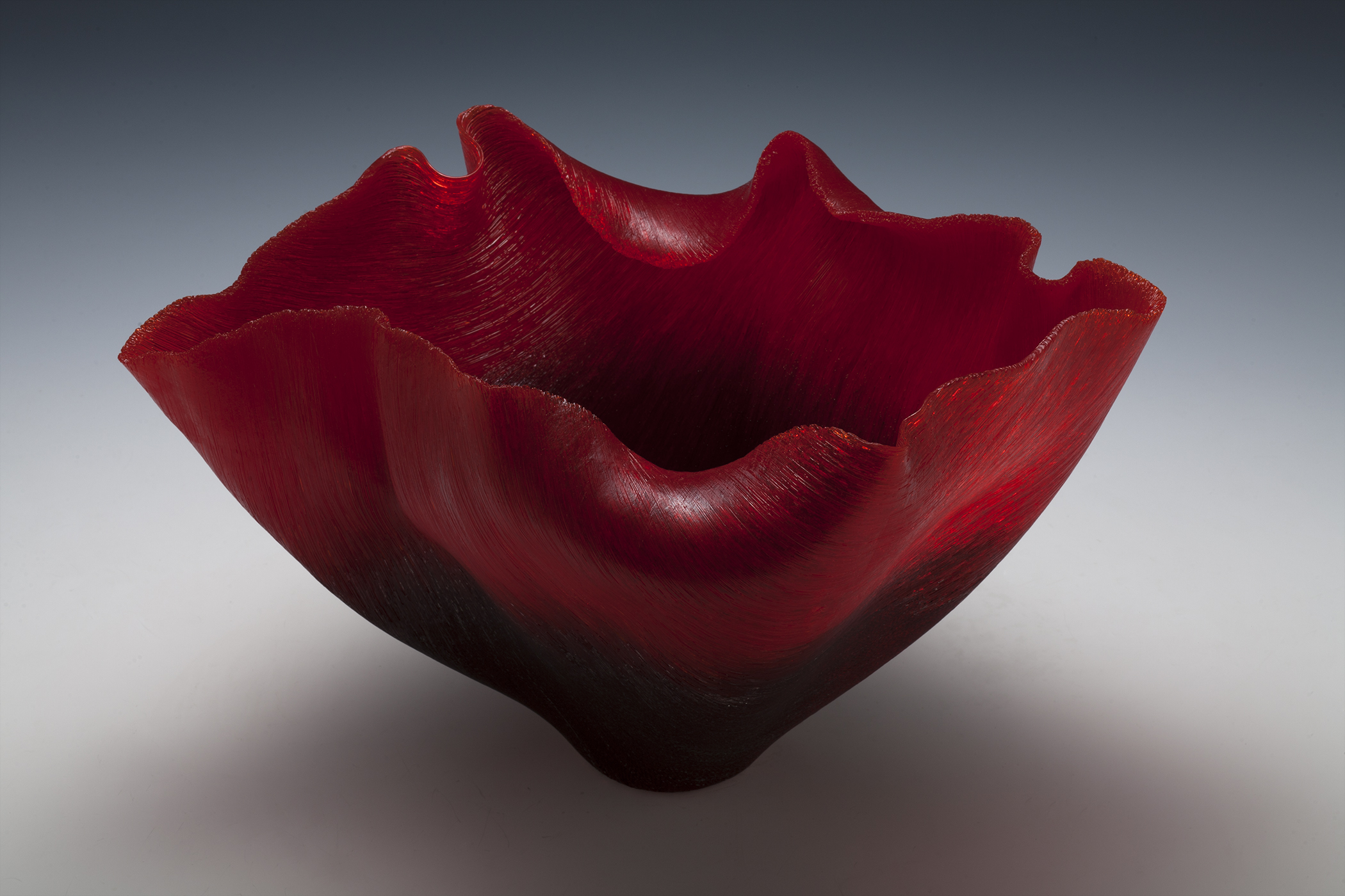 Fused and slumped red glass monofilaments sculpture by Toots Zynsky