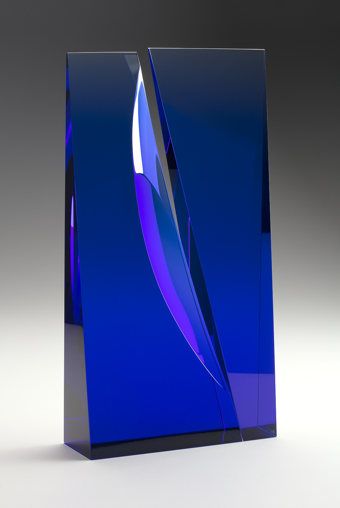 Laminated blue glass sculpture by Martin Rosol