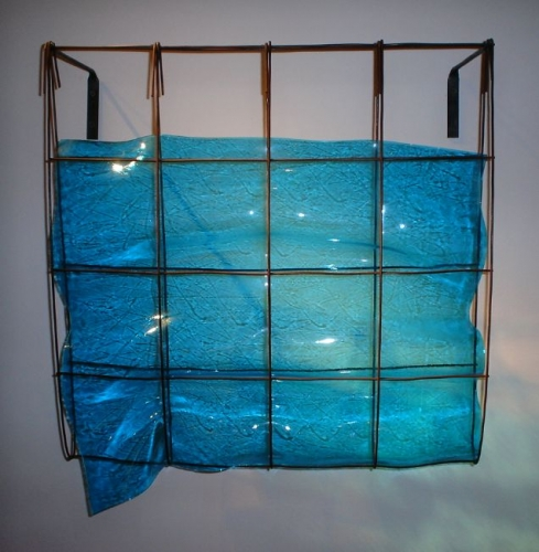 Blue slumped glass in metal wall hanging by Mary Shaffer