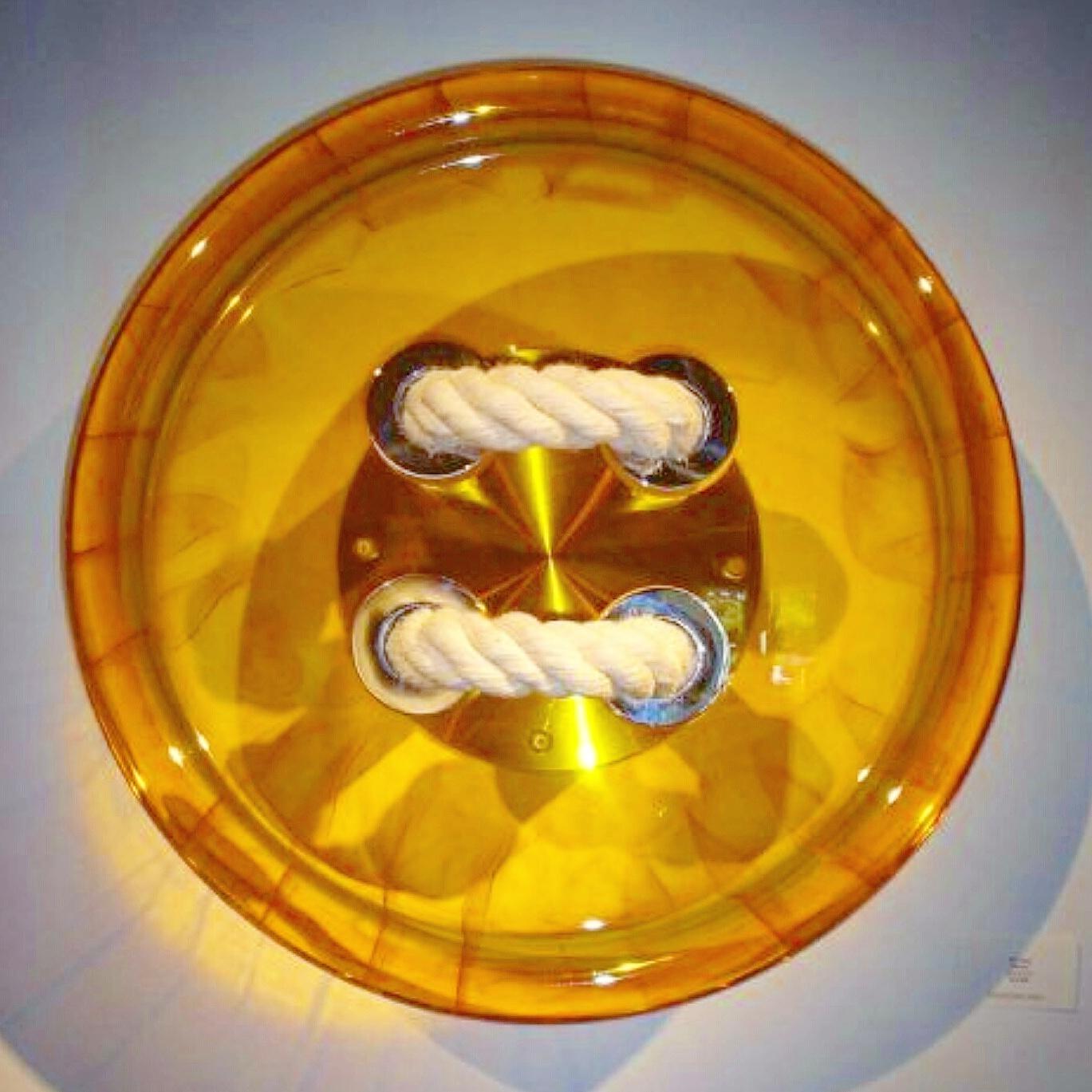 Button shaped Glass sculpture