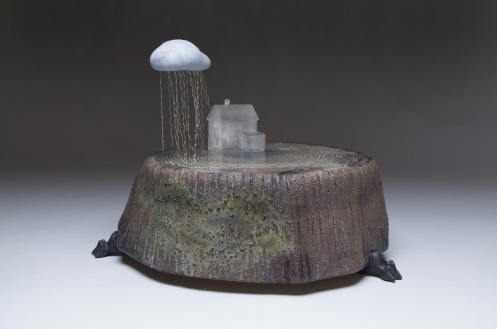 Glass house with rain cloud sculpture by Chadd Lacy
